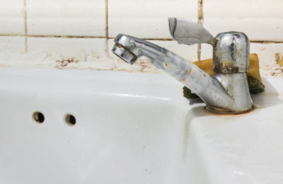 45308909 - image of old sink with damaged water tap .